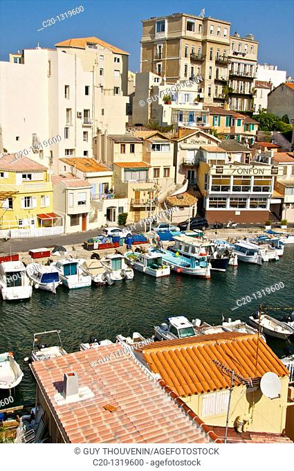 Typical Harbour and houses of the Vallon des Auffes, coast road/corniche, Marseille, Bouches du Rhone, 13, France, small homes and high building