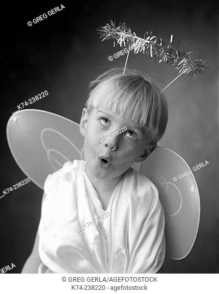 Young Boy In Angel Costume Making A Silly Face