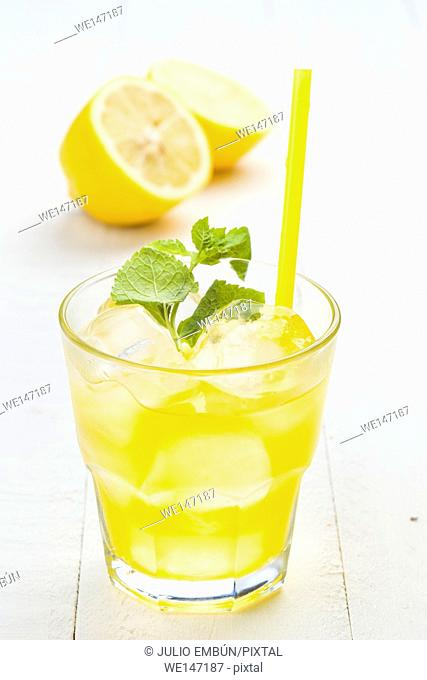 refreshing drink with lots of ice, white wood