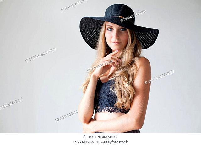 blonde girl with blue eyes a hat with a brim on a white background 1