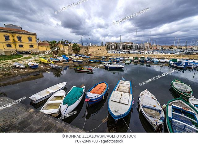 Local fisherman's boats at the marina in Syracuse city, southeast corner of the island of Sicily, Italy