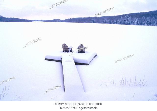 Adirondack chairs in a dock in winter. Poconos. Pennsylvania