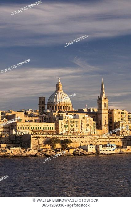Malta, Valletta, skyline with St  Paul's Anglican Cathedral and Carmelite Church from Sliema, sunset