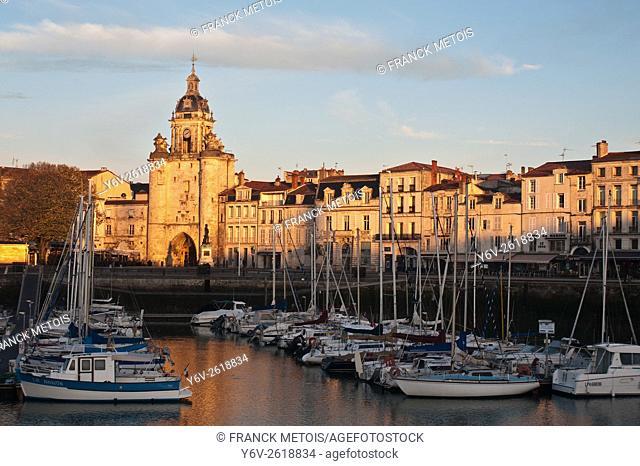 Old harbour of La Rochelle ( France). In the background, the city gate called ''porte de la grosse horloge''