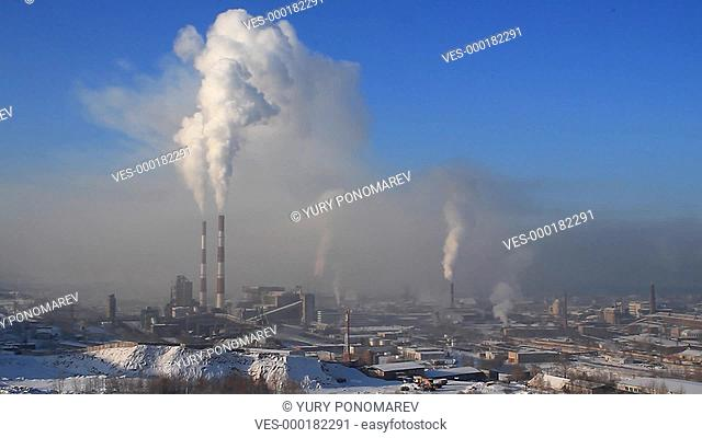 Industrial landscape with smokestacks pollute atmosphere
