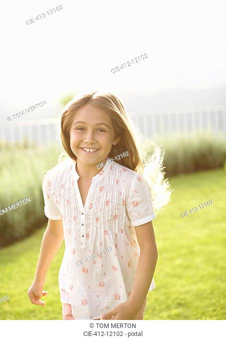 Happy girl running in grass
