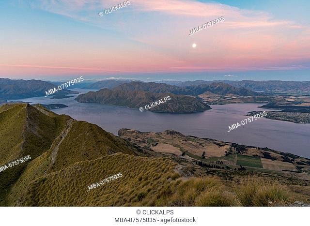 Moonlight over Lake Wanaka at sunset, Wanaka, Queenstown Lakes district, Otago region, South Island, New Zealand