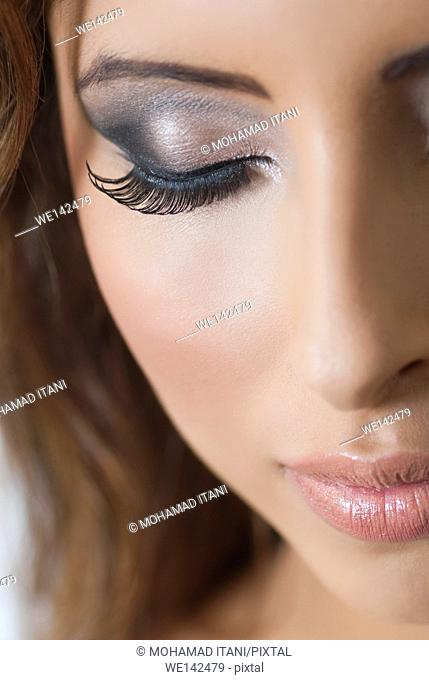Close up of a beautiful young woman with make up