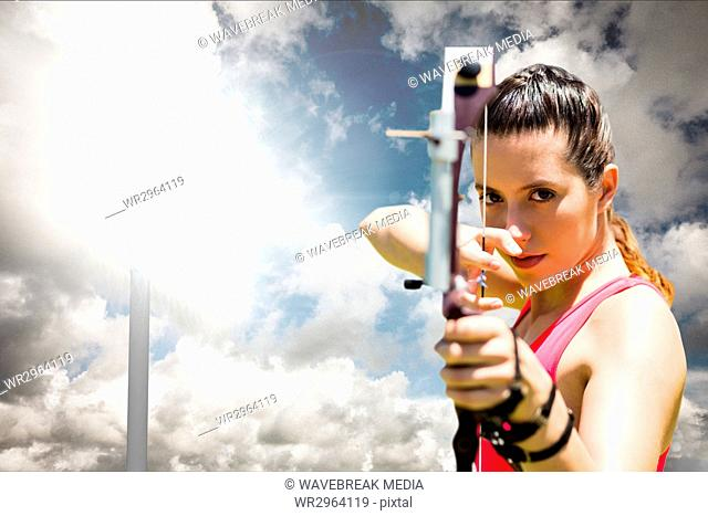 Woman playing archery with cloudy weather