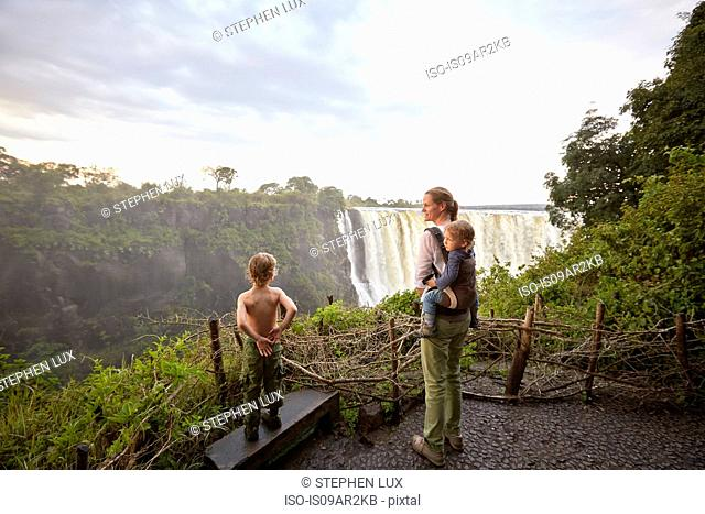 Mother and sons admiring view, Victoria Falls, Livingstone, Zimbabwe