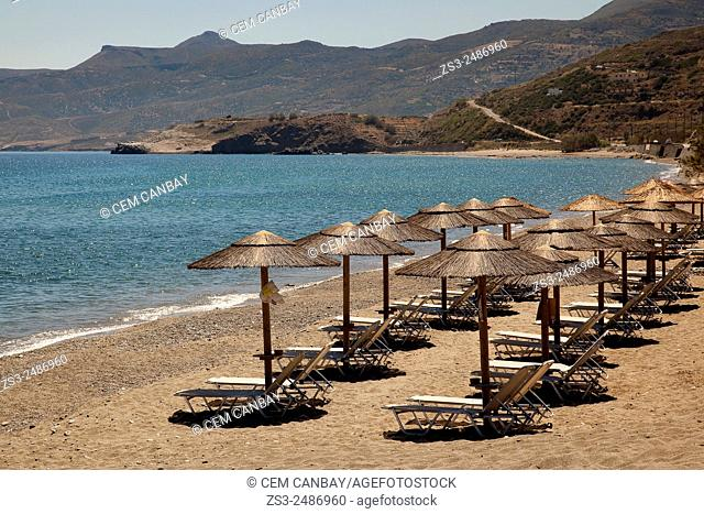 Tourists, sunbeds and umbrellas at the sandy beach, Sitia, Lasithi Region, Crete, Greek Islands, Greece, Europe
