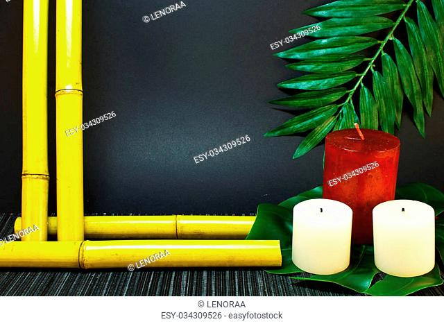 Template for spa bamboo, red and white candles and palm leaf