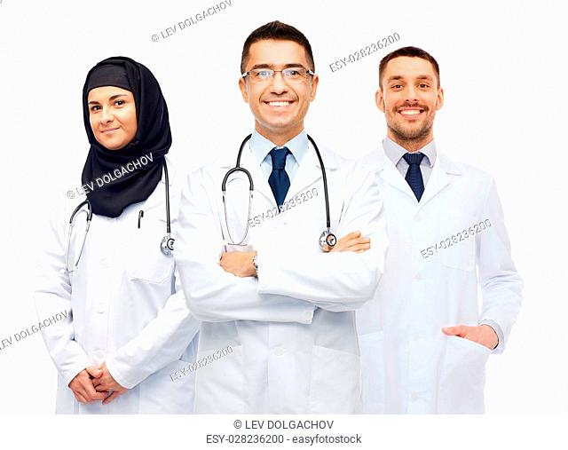 medicine, healthcare and people concept - happy smiling doctors in white coats with stethoscopes
