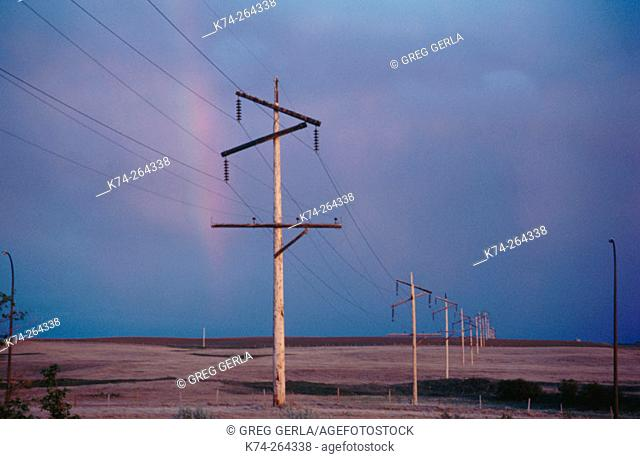 Power lines with rainbow. Southern Alberta. Canada