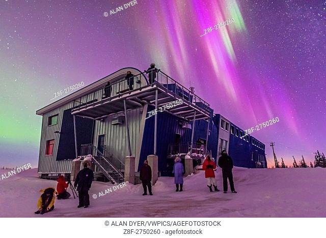 Our group of Learning Vacations tourists enjoy the start of a fine display of Northern Lights at the Churchill Northern Studies Centre, March 6, 2016