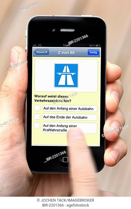 Iphone, smart phone, app on the screen, training for the driving theory test