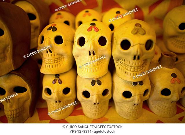 Ceramic skulls sit for sale ahead of Day of the Dead celebrations in a shop at the Jamaica Flower Market in Mexico City