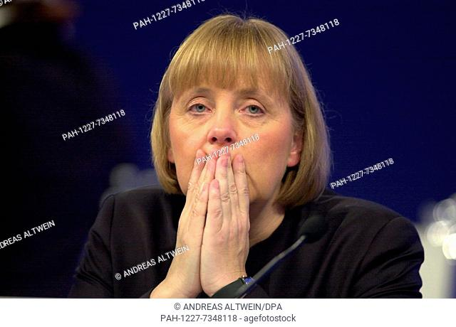 (dpa files) - Angela Merkel, chairman of the German Christian Democratic Party CDU, attends a party convention in Dresden, Germany, 3 December 2001