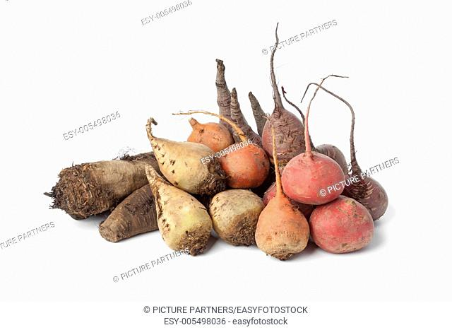 Variety of multi colored beets on white background