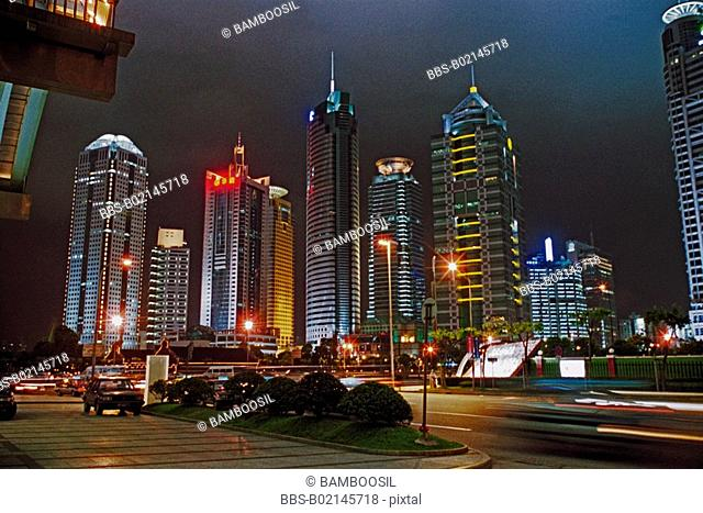 Low angle view of buildings at night, banking center of Pudong, Shanghai City of People's Republic of China