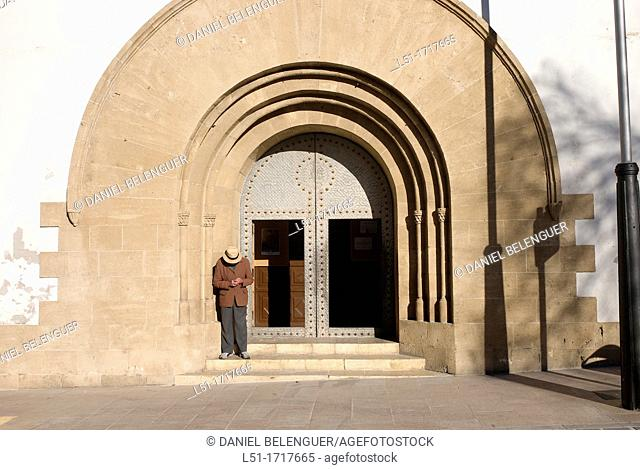 door of a church and begger, javea, Alicante, Spain