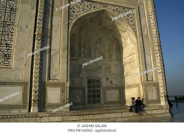 Tourists sit and enjoying beauty of the Taj Mahal The Taj Mahal sometimes called 'the Taj' was built by Emperor Shah Jahan in memory of his wife Mumtaz Mahal...