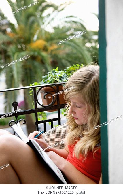 Girl sitting and writing diary