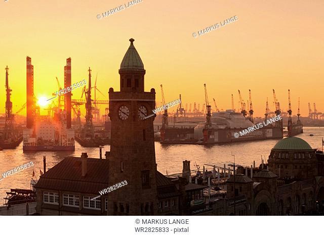 St. Pauli Landungsbruecken pier against harbour at sunset, Hamburg, Hanseatic City, Germany, Europe