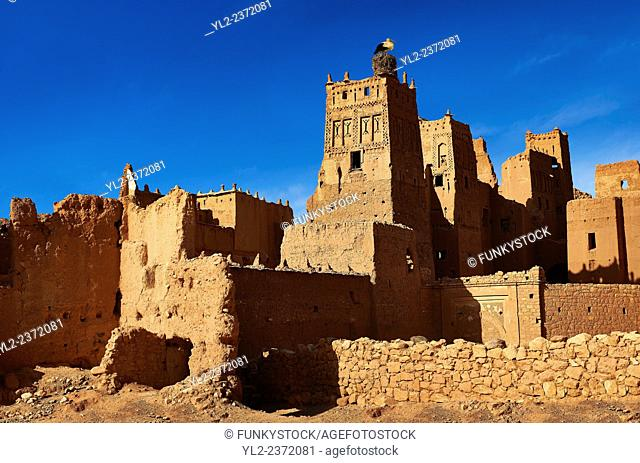 Stork nesting on the Glaoui Kasbah's of Tamedaght in the Ounilla valley set surrounded by the hammada (stoney) desert in the foothills of the Altas mountains