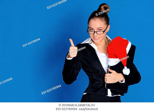Happy businesswoman with laptop, Christmas hat