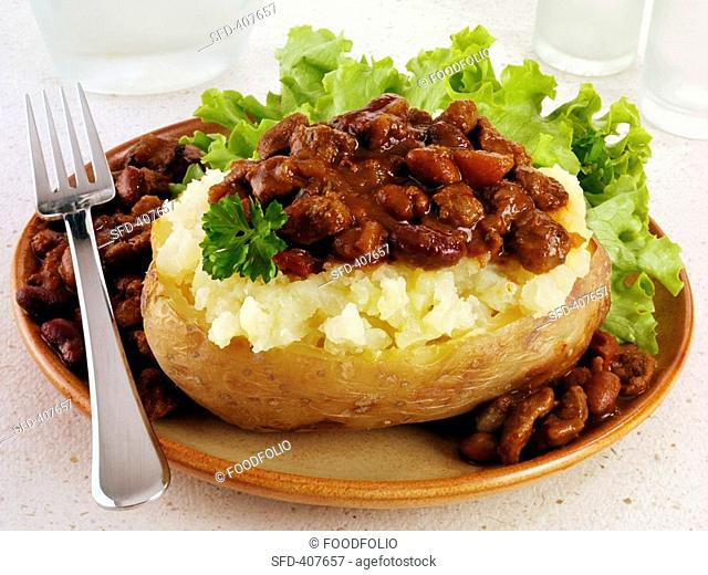A baked potato with chili con carne