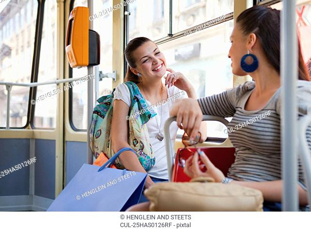 Young women talking in tram train