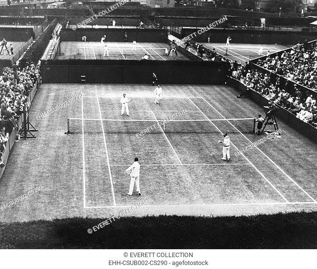 English lawn tennis championship play at Wimbledon, July 2, 1930. In closest court, a double matches was played by Bill Tilden of the US
