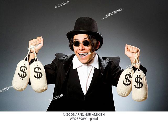 Funny man with dollar sacks