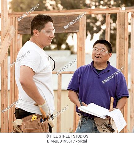 Construction workers talking together