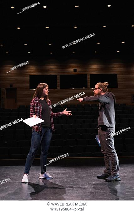 Male and female actress performing play on stage
