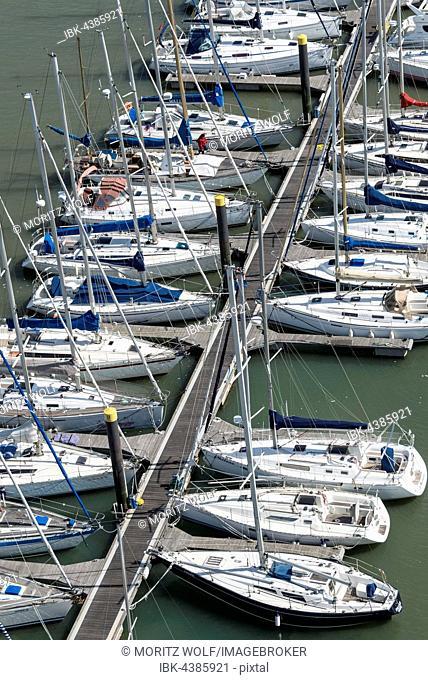 Sailing boats moored along jetty, River Tagus, Lisbon, Lisboa Region, Portugal