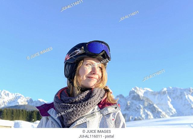 Young woman in skiwear looking away