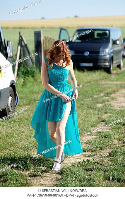EXCLUSIVE - The Austrian hit singer Allessa is photographed during filming on the field of a market garden in Oschatz, Germany, 18 June 2017