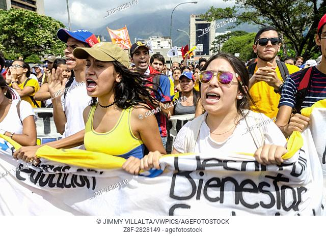 Demonstrators march during the anti-government protests in Caracas