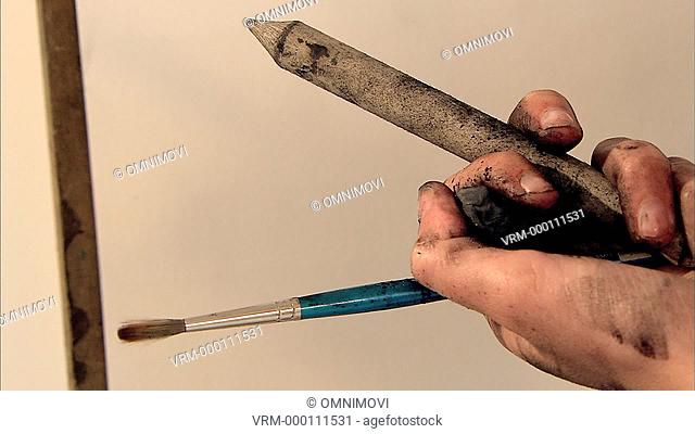 CU Drawing tools in woman's hand / Wimbledon, London, UK
