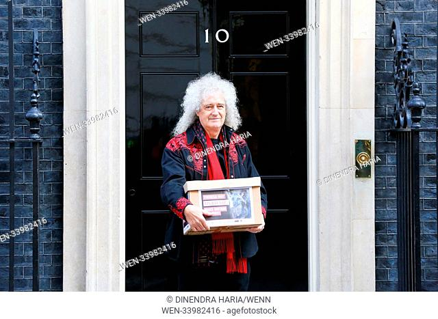 Queen guitarist Brian May alone with animal-protection campaigners including two wearing giant papier mâché fox and rabbit heads on the steps of 10 Downing...