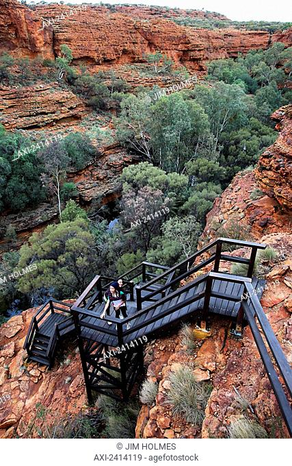 Tourists on the steps in Kings Canyon; Northern Territory, Australia