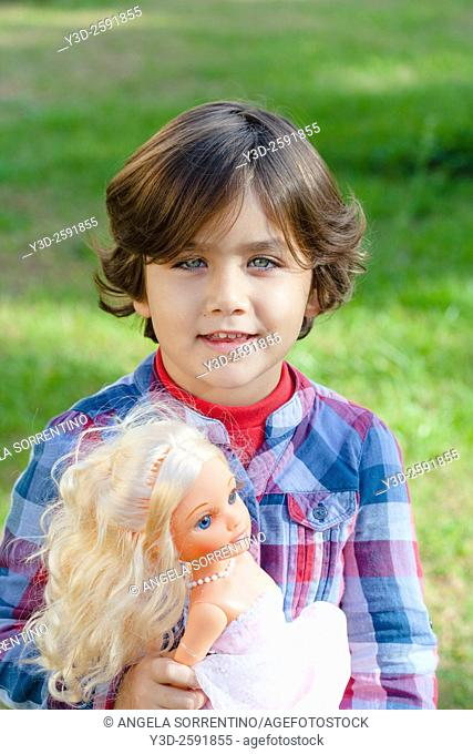 Little Girl Playing with Doll at Park, cute expression, beautiful blue eyes
