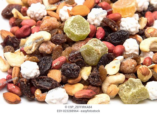 mixed dried fruit, nuts and seeds, healthy raisins, peanuts, papaya bananas and sweets