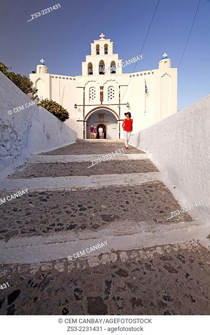 Tourists visiting St. Mary's Church with a two-storey bell tower from 1660, Pyrgos, Santorini, Cyclades Islands, Greek Islands, Greece, Europe