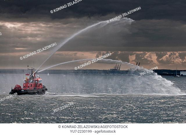 small fireboat demonstrating its capabilities on Baltic Sea in Gdansk, Poland