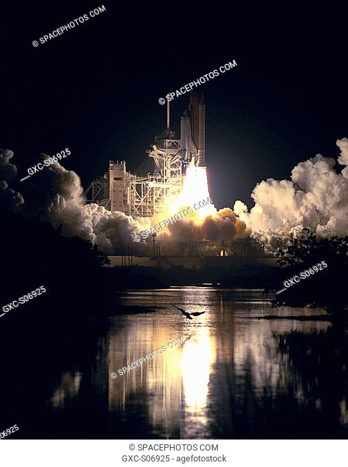 11/30/2000 -- As Space Shuttle Endeavour rockets off Launch Pad 39B, spewing clouds of smoke and steam, a majestic heron soars over the nearby water and...