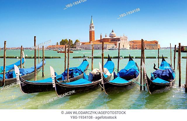 Venice - Grand Canal (Canal Grande), venetian gondola moored at the pier San Marco, Venice, Italy, UNESCO