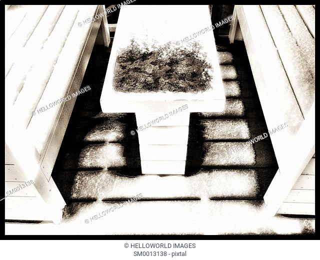 Wooden outdoor tables and seating covered in snow, Stockholm, Sweden, Scandinavia